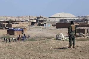Iraq paramilitaries say mass grave of hundreds found