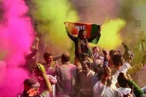 BJP workers play Holi as they celebrate party's victory in the UP and Uttarakhand assembly elections, at the party headquarters in New Delhi.