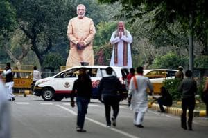 Giant cut-outs of Prime Minister Narendra Modi and BJP president Amit Shah were installed at the party headquarters in New Delhi after the party's victory in the Assembly elections.