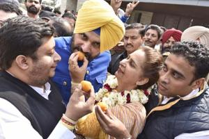 Navjot Sidhu's wife Dr Navjot Kaur Sidhu, along with other party supporters,during victory celebrations at their residence in Amritsar on Saturday.