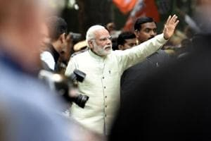 Prime Minister Narendra Modi waves to his supporters as he heads towards the BJP headquarters after victories in Uttar Pradesh and Uttarakhand elections, in New Delhi on Sunday.