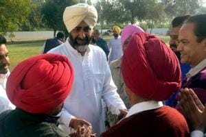 Newly-elected MLA and senior Congress leader Manpreet Singh Badal meeting party workers at Badal village in Bathinda on Sunday.