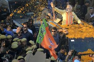 Prime Minister Narendra Modi waves at crowd during a road show in Varanasi on March 5. The BJP won the Uttar Pradesh assembly elections with a thumping majority.