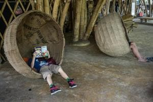 Reading from cover to cover:  Children immersed in their books at Green School in Badung, Bali, Indonesia.