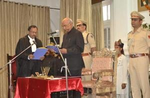 Bihar governor Ram Nath Kovind administering oath of office to Patna high court chief justice Rajendra Menon (left), in Patna on Thursday.