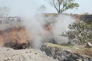 Emission of gas from subsided area at Bokapahari near Jharia