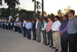IAS officers forming a human chain at the Raj Bhawan in Patna.