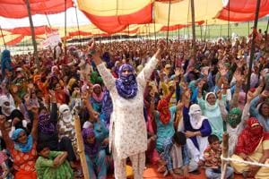 Protesters at the Jassia village in Rohtak district on Thursday.