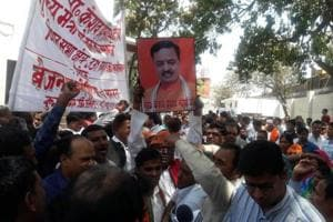 Supporters of BJP's Uttar Pradesh chief Keshav Prasad Maurya hold a demonstration in Lucknow, demanding that he be made the state's chief minister.