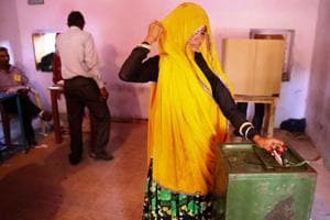 A woman casts her vote at Rozda village under Amer tehsil  of Jaipur district on Sunday.