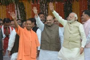 PM Narendra Modi and BJP chief Amit Shah attending the swearing-in ceremony of Yogi Adityanath as UP's chief minister in Lucknow.