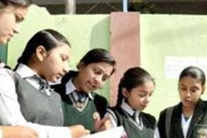 Students of Class 12 take a last look at their notes ahead of exams.