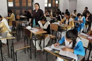 Students appear for annual board exams of high school at a centre in  Moradabad