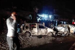 Iraqi officials say suicide car bombing kills at least 23 inBaghdad