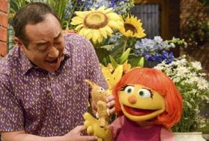This image released by Sesame Workshop shows Julia, a new autistic muppet character debuting on the 47th Season of Sesame Street on April 10.