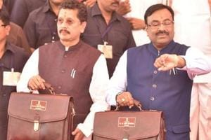 State Finance Minister Sudhir Mungantiwar (right) and MoS Deepak Kesarkar before presenting the Maharashtra budget recently.
