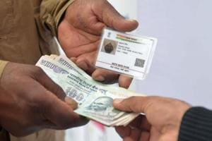 Govt wants mandatory Aadhaar for I-T returns, PAN card; cap on cash transaction lowered to Rs 2L