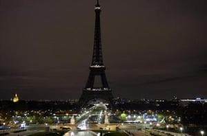 Paris' iconic Eiffel Tower goes dark at midnight in 'solidarity' with...