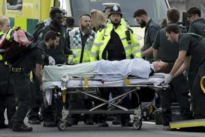 British police arrest seven suspects after London attack, revise death...