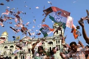 Congress workers scatter fake currency notes in the wind in support of the Narada sting operation, which showed several Trinamool leaders taking bribes.