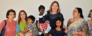 The adopted girls from Bhagalpur with their foster parents from Spain and New Zealand.