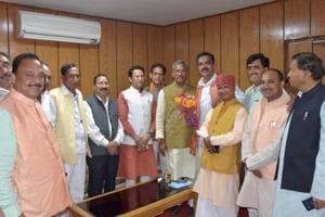 Newly elected MLAs welcome chief minister Trivendra Singh Rawat after the oath-taking ceremony at the assembly in Dehradun on Tuesday.