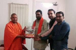 The chief of Gau Raksha Hindu Dal of Bishahra, Ved Nagar, felicitated for the group's cow protection mission by Yogi Adityanath in September 2016.