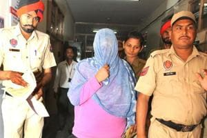 Police taking Seerat Kaur Dhillon for medical checkup at the civil hospital, Phase 6, SAS Nagar a few days back.