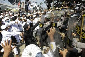 Indonesia police fire tear gas on Muslims protesting construction of...