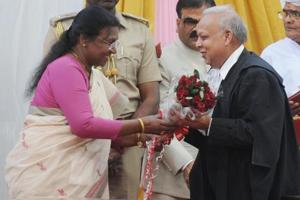 Governor Droupadi Murmu presenting bouquet after administering oath of office to Justice Pradip Kumar Mohanty as chief justice of Jharkhand High Court at Raj Bhawan in Ranchi