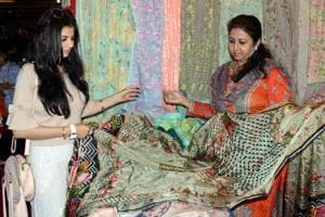 Visitors having a look at clothes during the IndoAsian Wedding and Lifestyle Exhibition in Ludhiana on Saturday.