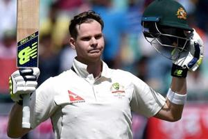 Steve Smith celebrates after reaching his century during the first day of fourth Test match against India in Dharamsala.