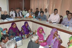 Women who lost  their husband to silicosis at a public hearing organised at the Rajasthan Mining Department on Monday.