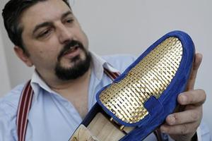 Gilt-y pleasure: Italian artisan crafts 24-carat gold shoes