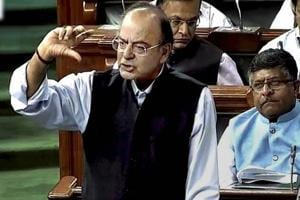 Jaitley, Chidambaram clash in Parliament over MS Dhoni's Aadhaar data...