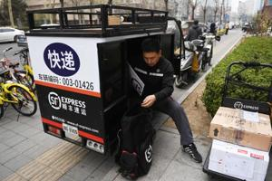 Wang wins: The illegal deliveryman who became one of China's richest...