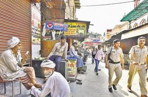 Policemen at the Jama Masjid Meat Market in Gurgaon on Wednesday.