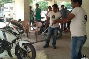 Cobra trapped in a motorcycle rescued by NGO in Ghaziabad