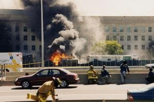 Smoke billows from the Pentagon after American Airlines flight 77 crashed into the building on September 9, 2001.