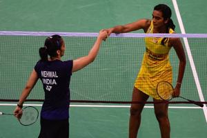 PV Sindhu (right) shakes hands with Saina Nehwal after winning the women