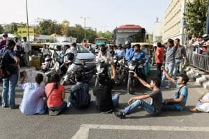 JNU students block traffic during a protest outside the UGC building in New Delhi.