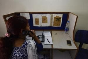 A volunteer at Snehi attends to callers. The organisation has reduced its operation time from eight hours, seven days a week to five hours six days a week.