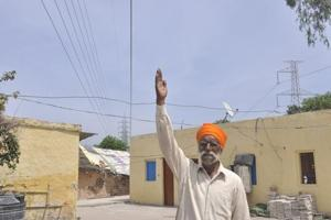The passing of low-hanging high-tension wires just inches above the roofs of house is grave ganger that affects the lives of residents in the area.