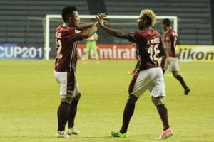 Mohun Bagan A.C.'s Sony Norde and Jeje Lalpekhlua celebrate after the former scored against Abahani Limited Dhaka during a 2017 AFC Cup match.