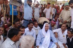 Former union minister Yashwant Sinha along with supporters staging a dharna after district administration arrested them allegedly tried to take out a religious procession in Hazaribagh  on Tuesday
