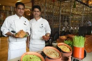 Executive chef Naveen Handa (right) with sous-chef de cuisine Ashish Kumar presenting scrumptious delicacies for the Baisakhi food festival.
