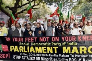Activists of Social Democratic Party of India shout slogans during a protest march against attacks on minorities, Dalits, backward classes in New Delhi.