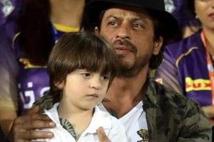 Shah Rukh Khan, co-owner of Kolkata Knight Riders, and son AbRam Khan during the 2017 Indian Premier League between KKR and Gujarat Lions in Rajkot on Thursday.