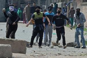 Kashmiri protestors clash with security forces near a polling station in Srinagar on Sunday.