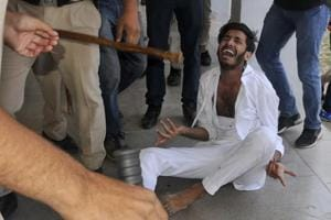 A student assaulted in the police action during a protest  against fee hike at Panjab University, Chandigarh, on Tuesday, April 11.